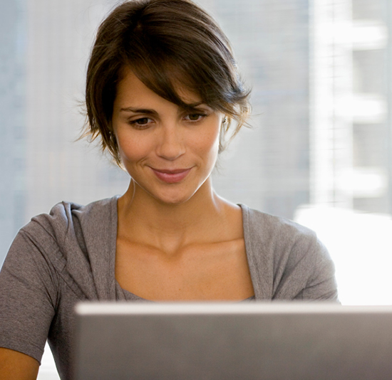 woman sitting with computer